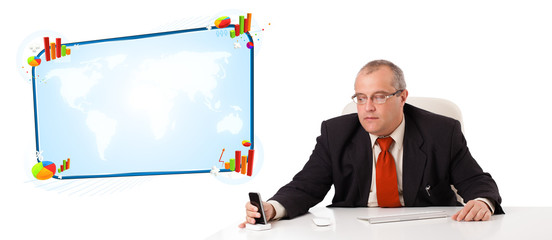 businessman sitting at desk and holding a mobilephone with copy