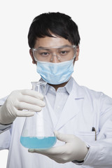 Scientist Holding Beaker