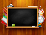 Fototapety Blackboard with school supplies on wooden background. Vector