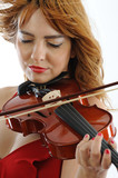 Beautiful girl with violin focused on hand