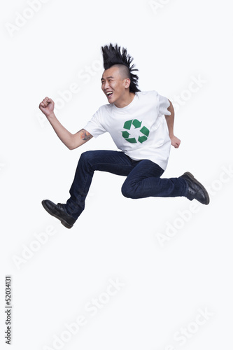 Young man with Mohawk jumping
