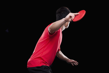 Man playing ping pong, black background