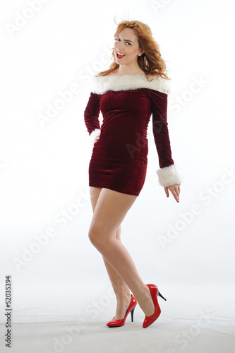 Sexy girl wearing Santa Claus clothes with red shoes