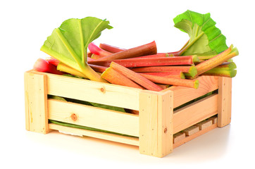Fresh rhubarb in wooden crate