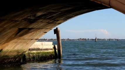 View to boats in Venice from under a bridge