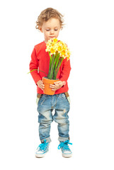 Toddler boy smelling flowers