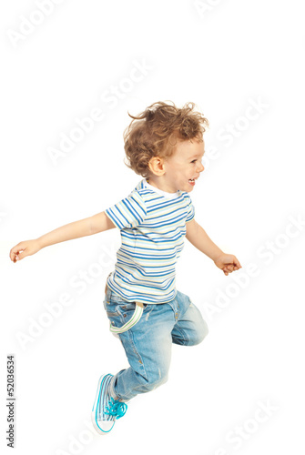 Happy kid boy jumping