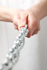 hands holding a chain. isolated on white background