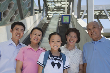Family standing next to the escalator near the subway station