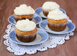 Coconut cupcakes on saucers