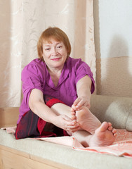 woman treats her toenails