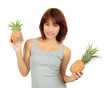 Isolated young asian woman with pineapple