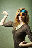 Funny sports girl in sunglasses with fake biceps