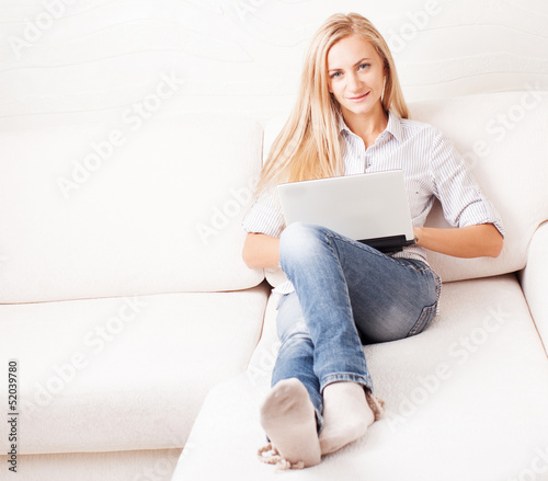 Woman on the sofa with laptop