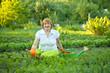 Happy mature woman working in garden