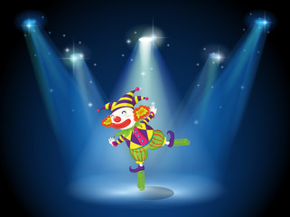 A stage with a playful clown