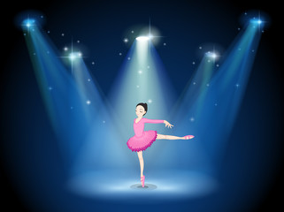 A lady in pink dancing ballet with spotlights