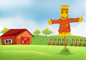 A farm with a barn and a scarecrow