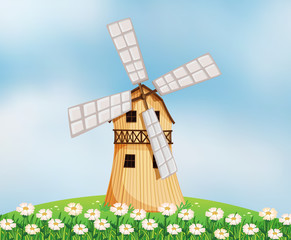 A barn with a windmill