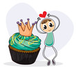A boy dancing beside a cupcake