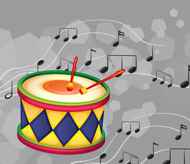 A drum with musical notes