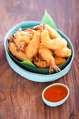 Shrimp tempura with spicy chili sauce, selective focus
