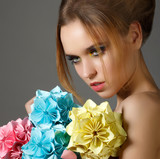 Beautiful Bright Woman holding Bouquet of Paper Origami Flowers