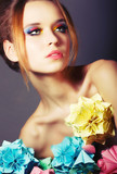 Young Beauty with Colorful Origami Flowers. Bright Eye Make-Up