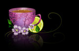 Cup of tea with lemon and flowers