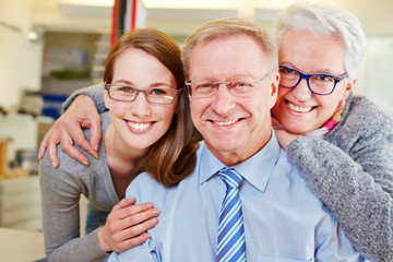 Family with seniors at optician with glasses