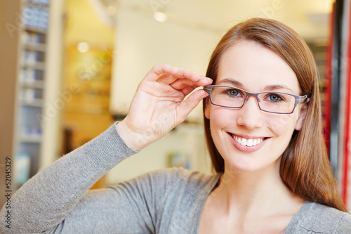 Attractive woman with new glasses