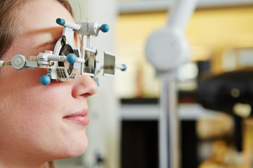 Woman at optician with trial frame