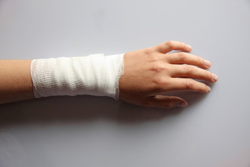 bandaged arm of a child because of a skin lesion