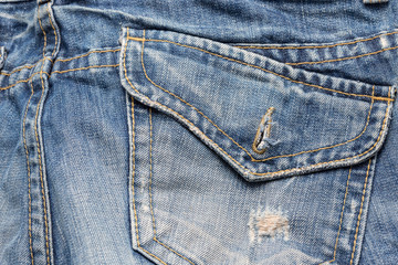 Rear pocket of Blue Jeans