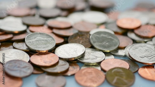 Many different coins on a table