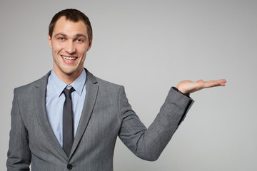 young business man holding something imaginary in his hand