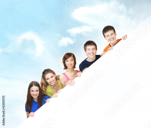 Group of teenagers with a giant, blank, white billboard