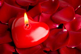 Heart red candle and rose petals