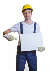 Bauarbeiter mit Schild