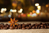 Fototapety Coffee and Star Anise on sackcloth background with night lights