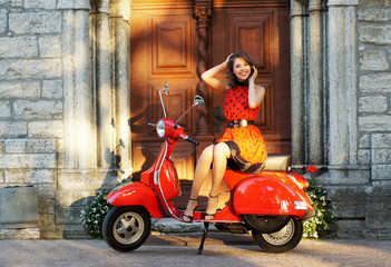Vintage photo of a young and lovely woman and an old scooter