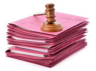 Judge gavel and soundboard on stack of files isolated