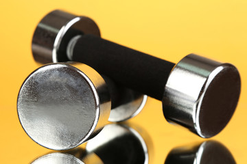 Dumbbells at 2 kg on yellow background