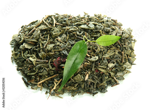 Dry tea with green leaves, isolated on white