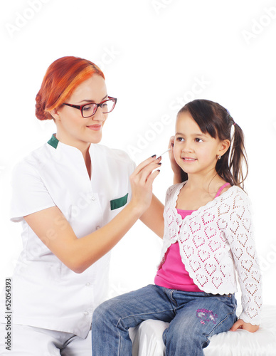 A female doctor and a little girl isolated on a white background