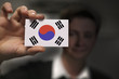 Businessman is holding a business card, flag of South Korea