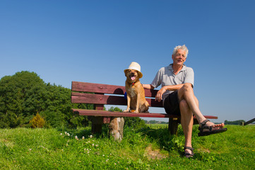 Man and dog with hat