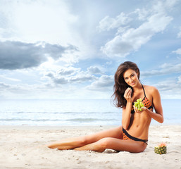 Young, healthy, beautiful and sexy woman eating grapes