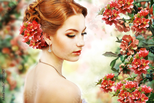 Red Hair Beauty over Natural Floral Background. Nature. Blossom