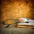 Rading glasses and newspaper